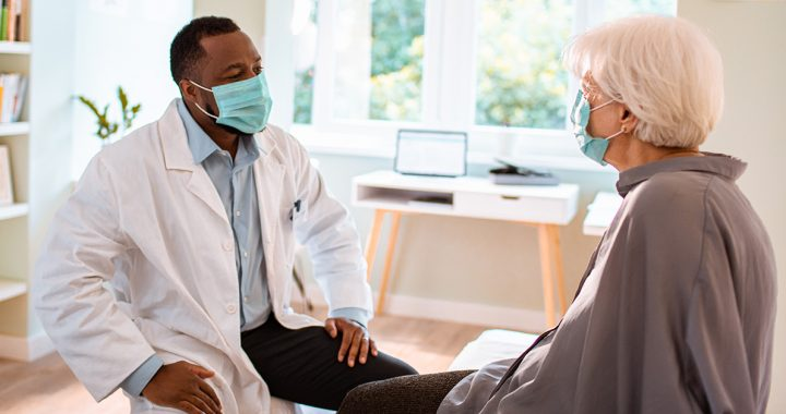 A man meeting with his primary care provider.