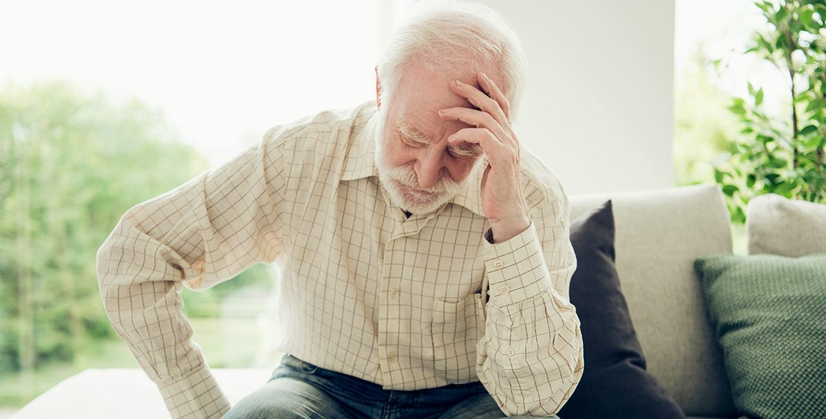 A man experiencing the signs and symptoms of a stroke