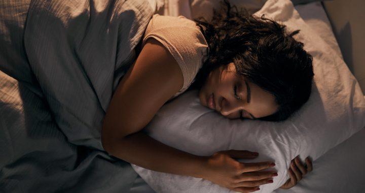 Woman sleeping in a dark room.