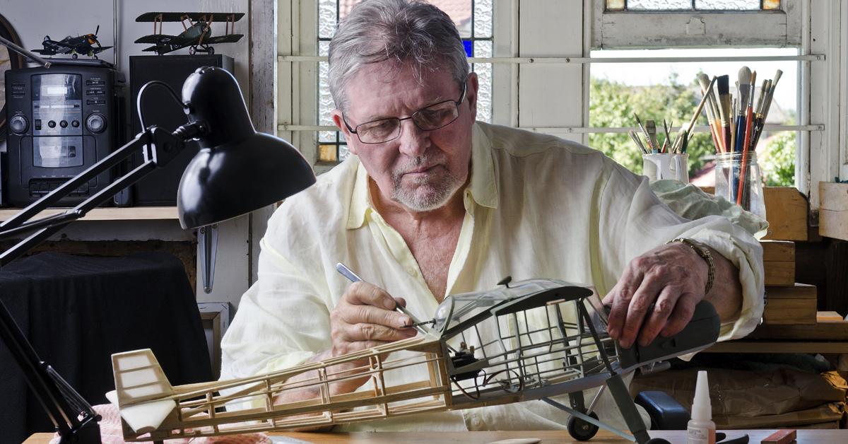 Man enjoying hobbies at home.