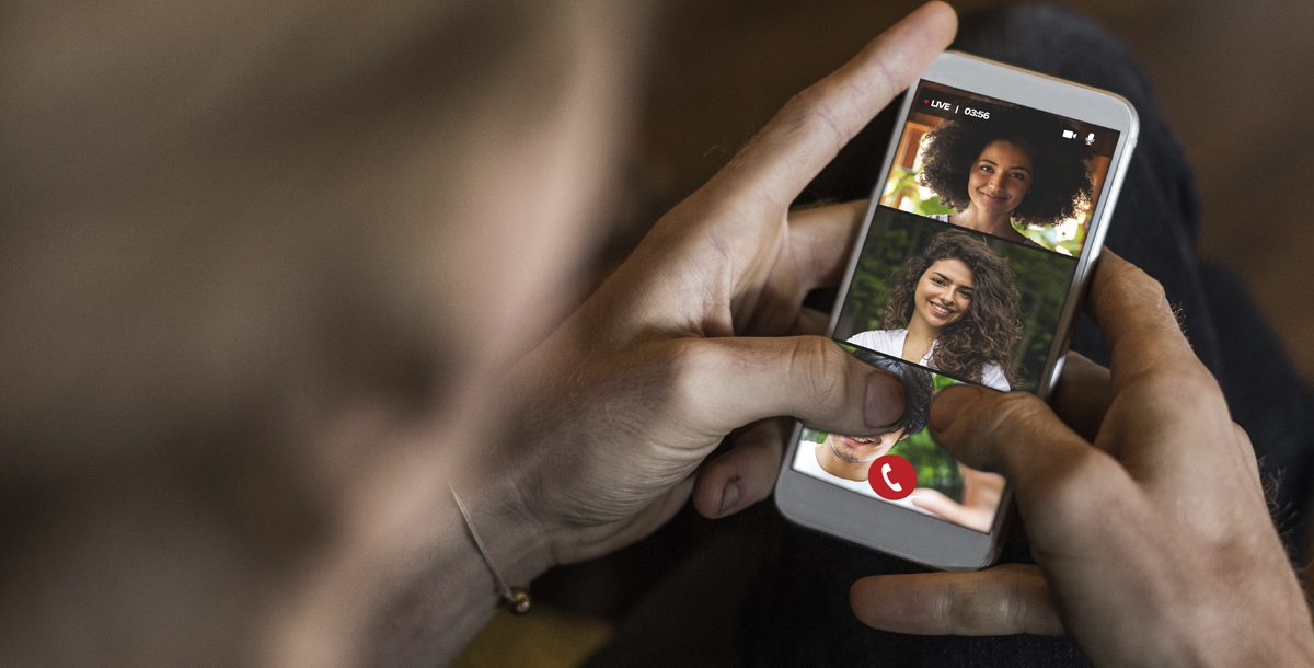 A person communicating with family members over video chat during COVID-19