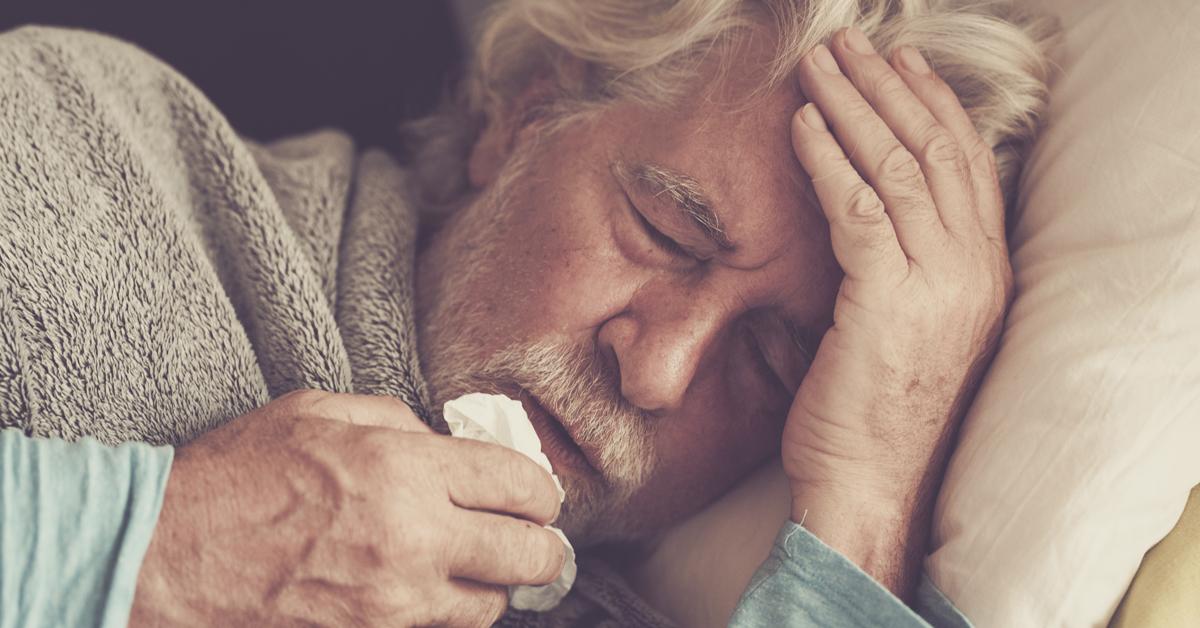 Sick man managing his illness symptoms at home