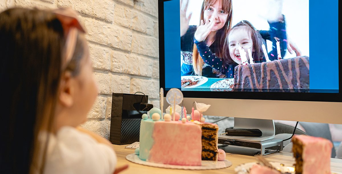 Family hosting a virtual birthday party for their child during COVID-19.