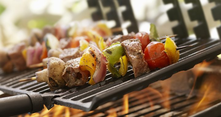 someone grilling healthy chicken kabobs during the summer