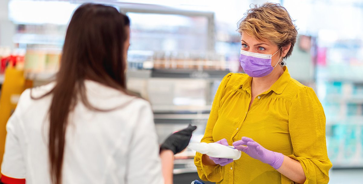 Woman shopping with latex gloves during COVID-19.