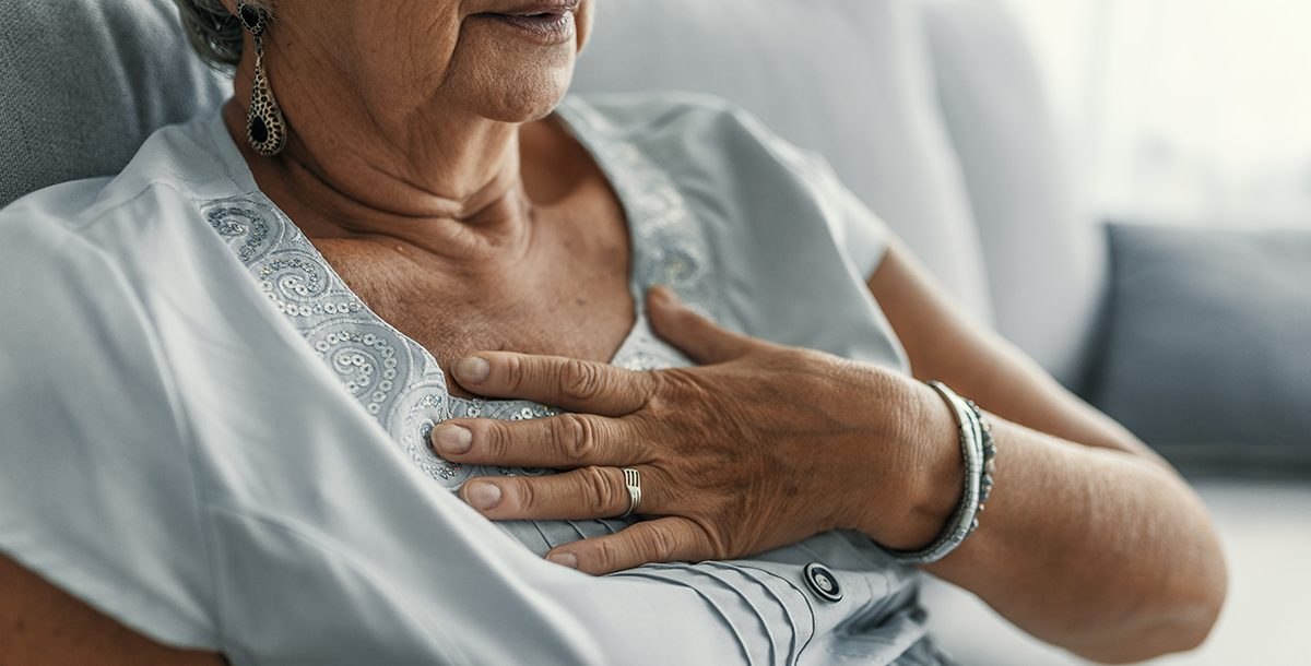A woman experiencing gas pain in her chest.