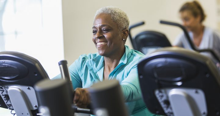 A woman doing cardio at the gym during COVID-19