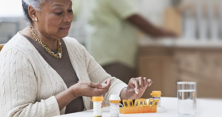 A woman managing her medications at home during COVID-19.