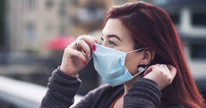 A woman wearing her face mask correctly during COVID-19.