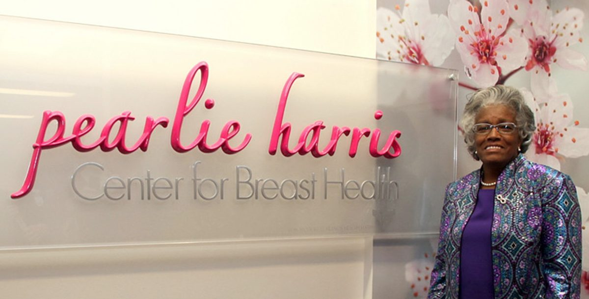 Pearlie Harris next to her sign at the Bon Secours breast cancer center in Greenville, SC