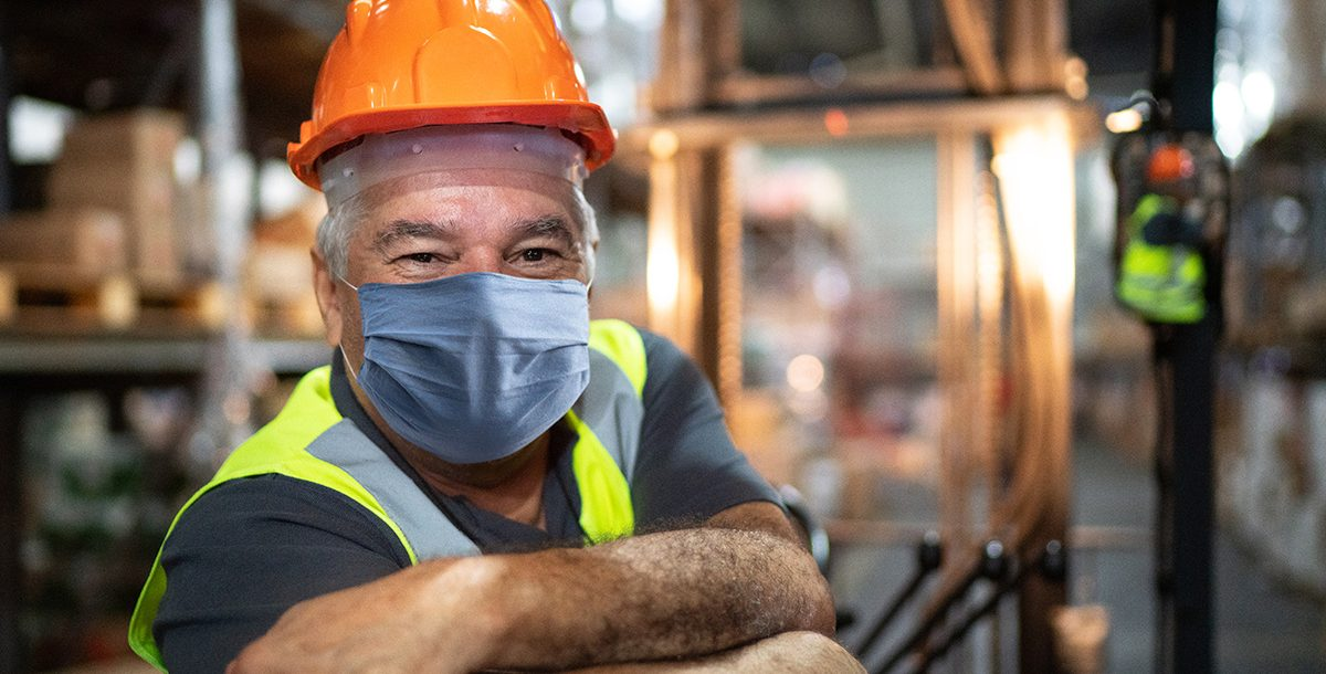 A man wearing his face mask while at work.