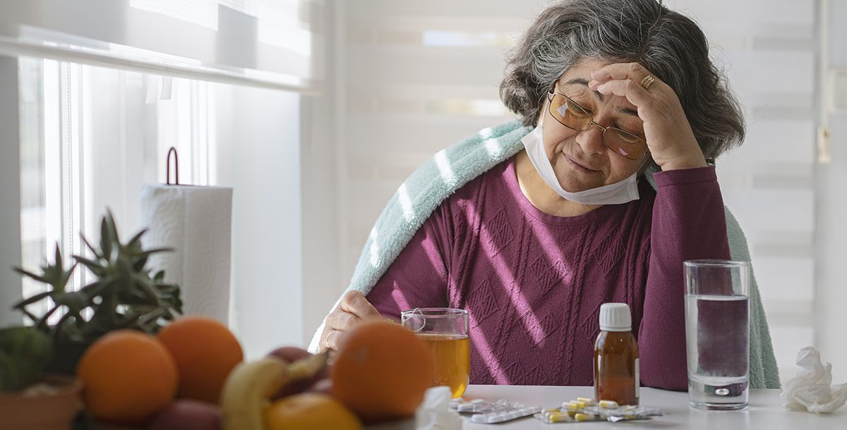 An older adult experiencing flu symptoms.
