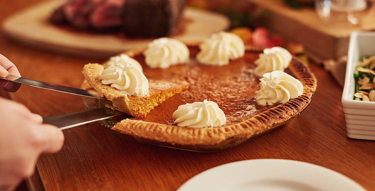 A pumpkin pie on a table