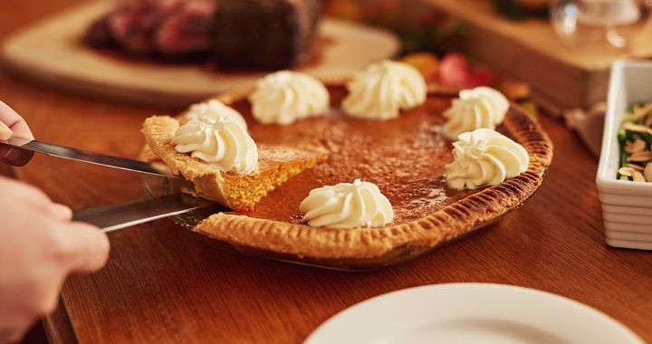 A pumpkin pie on a table