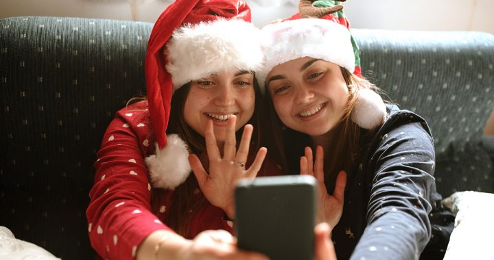 Two people enjoying a holiday video call.