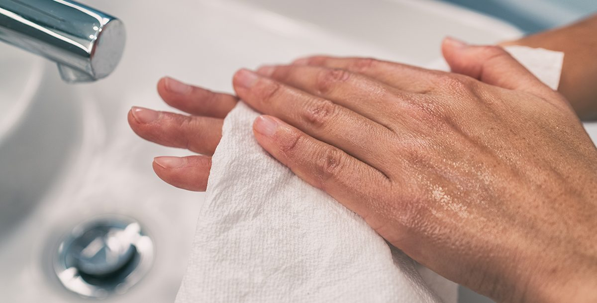 A person with dry hands from lots of handwashing.