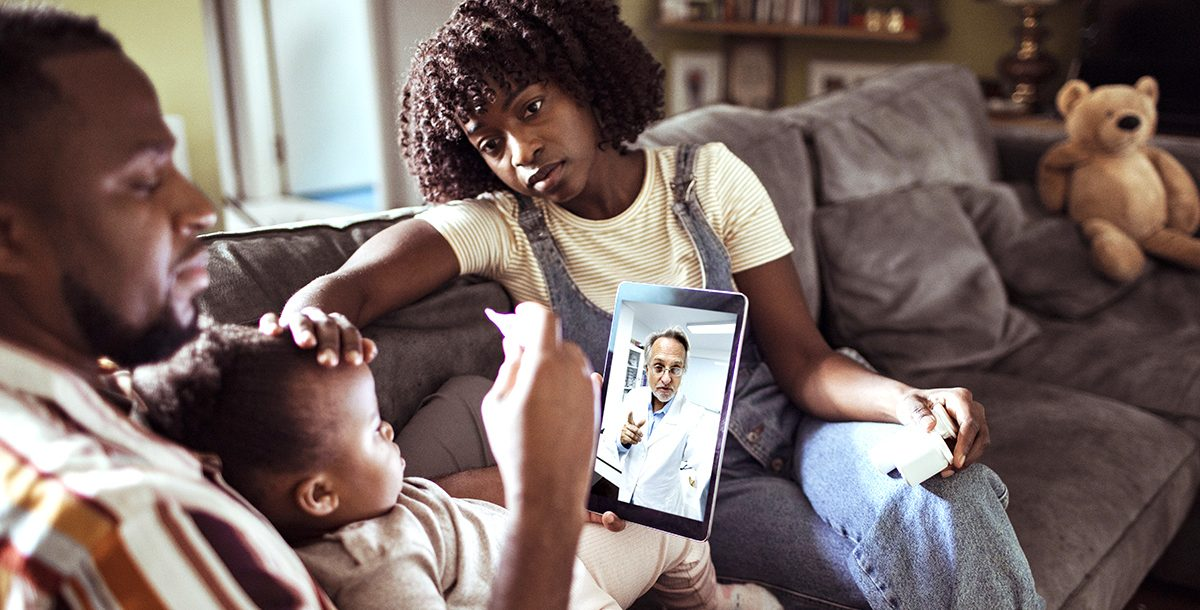 A family participating in a video visit with their provider.