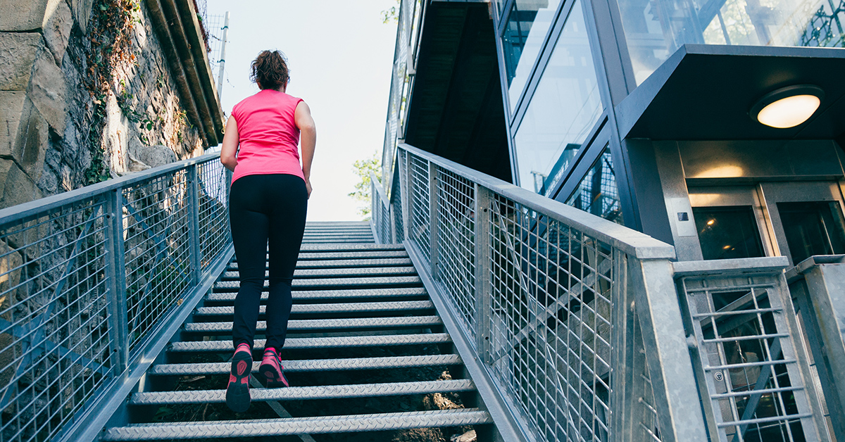 A woman climbing stairs for exercise.