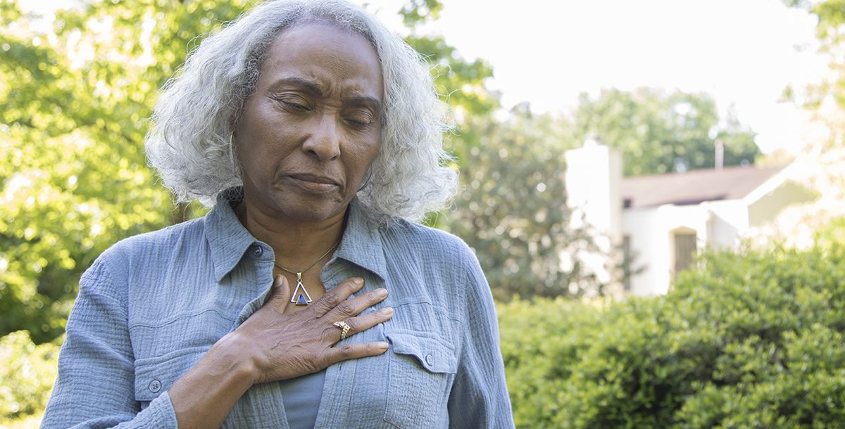 A woman experiencing heart pain