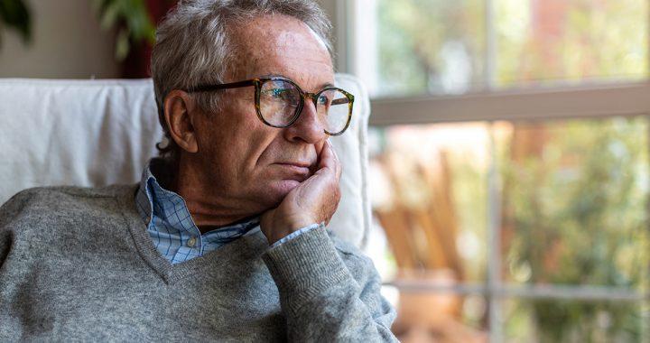 An older man looking concerned.