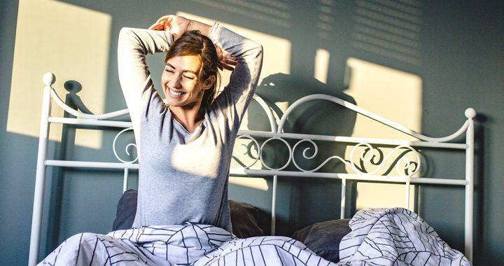 A woman waking up to sunrise.