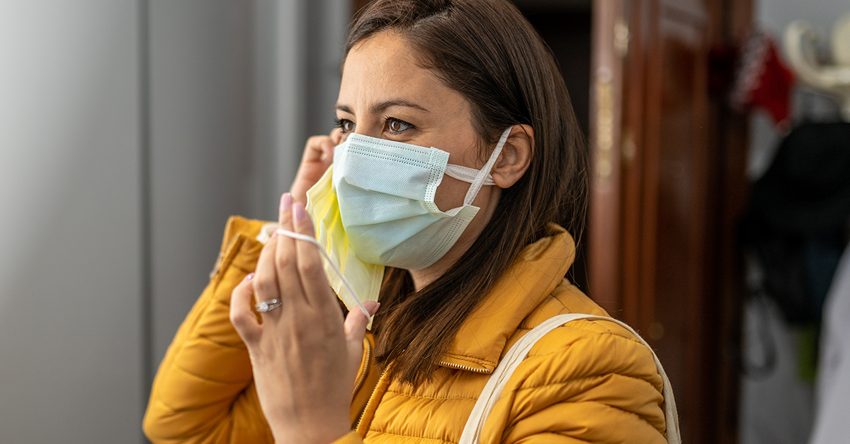 A woman wearing two face masks in public.
