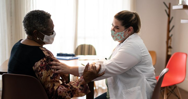 A woman meeting with her health care provider.