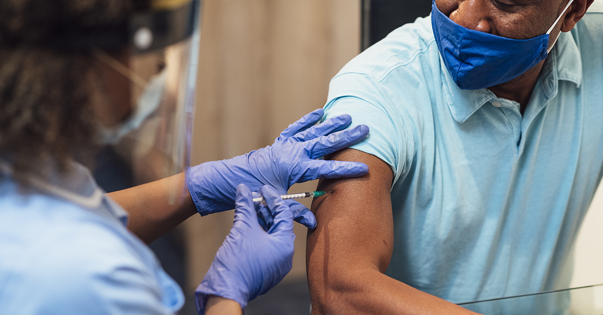 A man receiving his covid-19 vaccine.