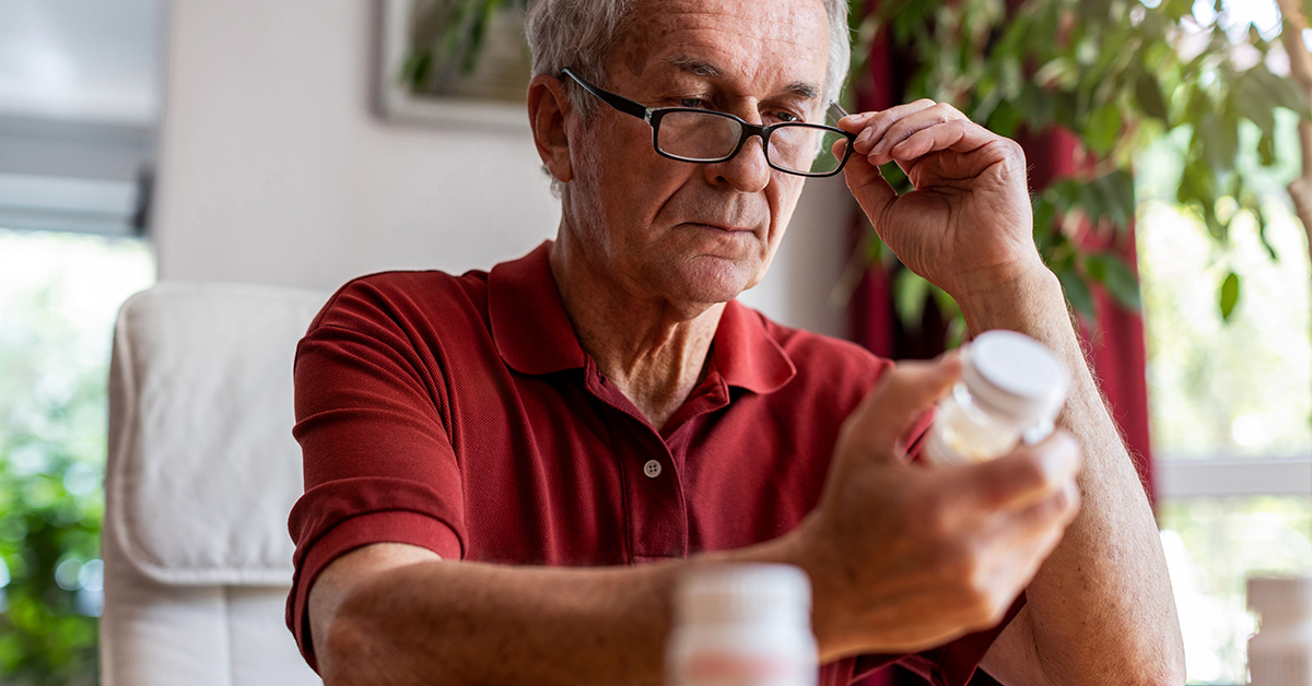 A man comparing medications.