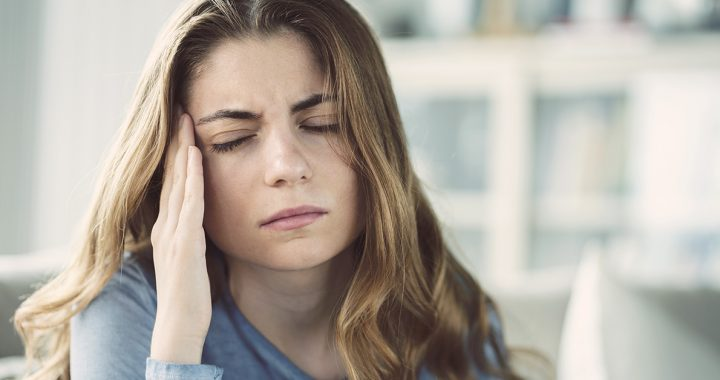 A woman experiencing side effects from her COVID-19 vaccine.