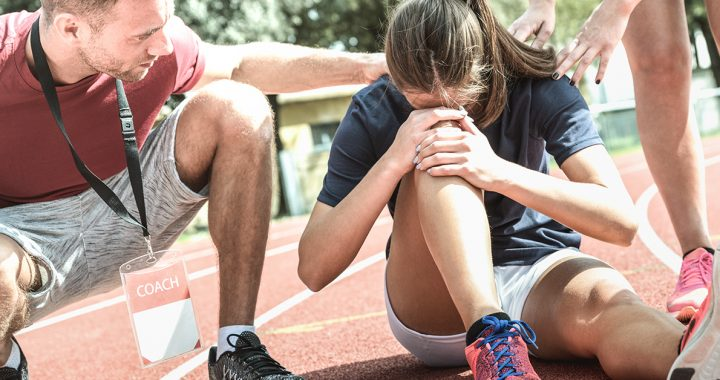 A woman experiencing a common summer injury from running.