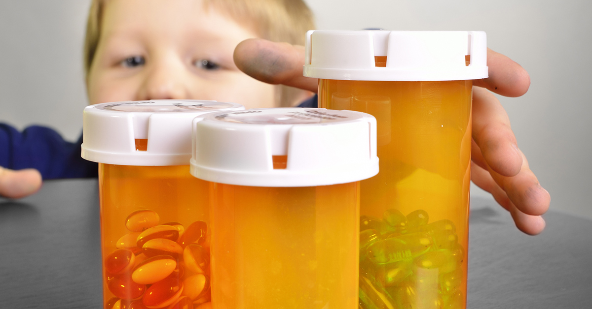 A kid reaching for pill bottles.