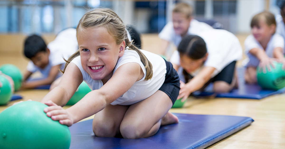 A child participating in PE class at school.