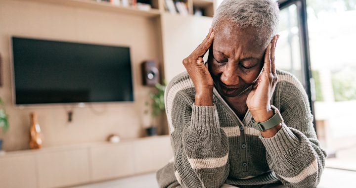 A woman suffering from a migraine