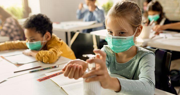 Kids wearing face masks in school.