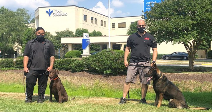 AK9I dogs and their trainers outside of Mary Immaculate Hospital