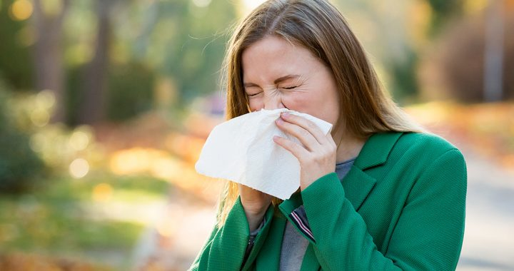 A woman suffering from fall allergies.